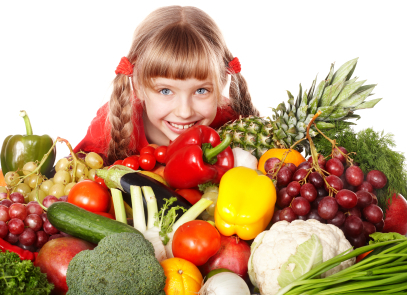 girl with mound of raw fruit and veggies